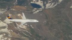 Airplane flying over the Alps - stock footage