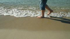 Walking in the sand by the sea Stock Footage