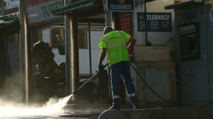 Pressure cleaning the streets Stock Footage