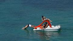 Tourists on a paddle boat - stock footage