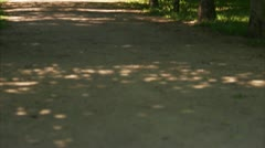 Woman running in a park - stock footage