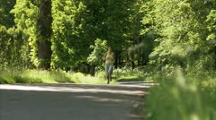Scandinavian woman jogging - stock footage