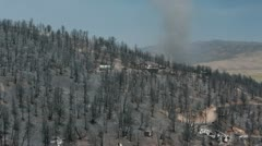 Forest wildfire homes destroyed twister crosses hill P HD 0953 Stock Footage