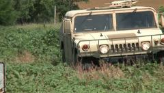 Hummvee driving 2PR Stock Footage