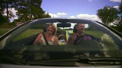 A couple singing in a cabriolet - stock footage
