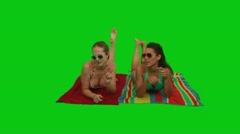 Girls lying on the towel and dancing with their hands Stock Footage