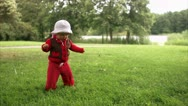 A little girl toddling around, Stockholm Stock Footage