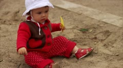 A little girl sitting in a sandpit playing, Stockholm Stock Footage