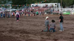 Rodeo kids exercise before pig chase P HD 1128 Stock Footage