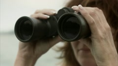 A woman using a pair of binoculars, Stockholm archipelago Stock Footage
