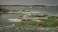Stock Video Footage of A woman walking on cliffs, Huvudskar, Stockholm archipelago
