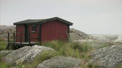 A red cottage, Huvudskar, Stockholm archipelago Stock Footage