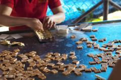 Locals in Hou Chi Minh (saigon), Vietnam, making toffee for tourists. - stock photo