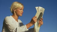 A young woman reading a newspaper, Blido, Stockholm archipelago Stock Footage