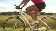 A woman riding a bike in the countryside Stock Footage
