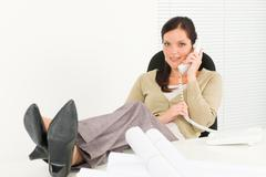 calling professional architect woman in office - stock photo