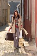 autumn outfit shopping woman elegant with bags - stock photo