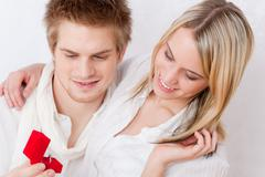 Stock Photo of couple in love - romantic engagement ring