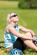 Sport mountain biking girl relax in meadows Stock Photos