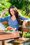garden terrace beautiful woman fresh summer melon - stock photo