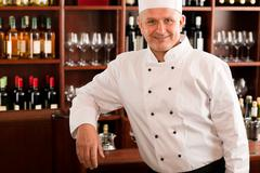 chef cook confident professional posing restaurant - stock photo