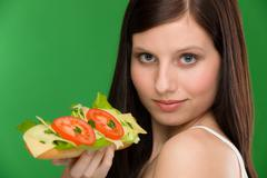 healthy lifestyle - woman enjoy cheese sandwich - stock photo