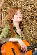 Young country woman relax with guitar Stock Photos