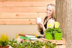 garden woman terrace enjoy cup coffee spring - stock photo