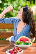 Fresh cherries melon woman garden summer terrace Stock Photos