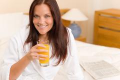 breakfast - smiling woman with fresh orange juice - stock photo
