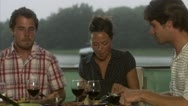 Four friends having dinner Stock Footage