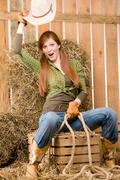 crazy young cowgirl horse-riding country style - stock photo