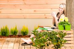 garden woman terrace enjoy cup coffee spring - stock photo
