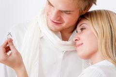 Couple in love - romantic engagement ring Stock Photos