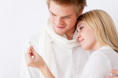 couple in love - getting engagement ring - stock photo