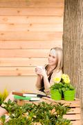 Garden woman terrace enjoy cup coffee spring Stock Photos