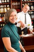 wine bar senior woman enjoy wine glass - stock photo