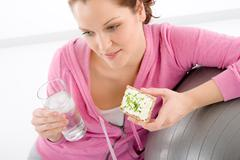Fitness woman relax glass water snack sportive Stock Photos