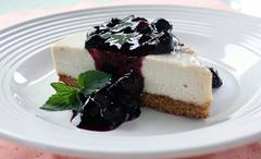 Blueberry cheesecake slice in close up Stock Photos