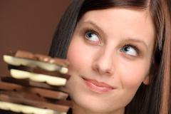 Stock Photo of chocolate - portrait young healthy woman