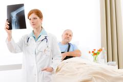Stock Photo of hospital - female doctor examine x-ray patient