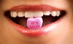 love  candy on beautiful woman macro mouth - stock photo