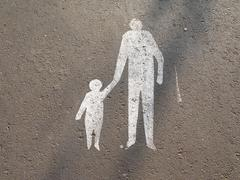 Stock Photo of pedestrian sign with father and child painted on street