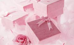 Pink gift box with pink ribbon on pink background Stock Photos