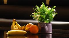 Banana and orange and flower Stock Photos