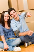 moving new home young couple hold keys - stock photo