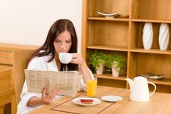 Breakfast at home happy woman read newspapers Stock Photos