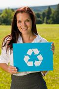 recycling sign - young businesswoman sunny meadow - stock photo