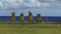 Moai statues in a line by the sea on Easter Island Stock Footage