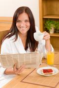 Stock Photo of breakfast at home happy woman with coffee